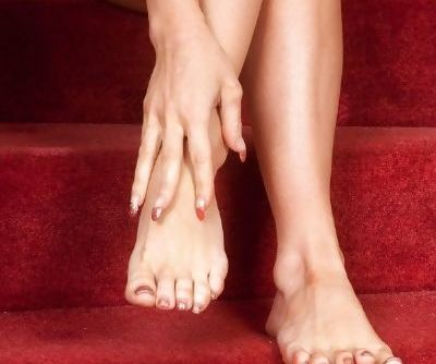 Hot blonde Natalia Forrest massages her bare feet and splays her sexy toes