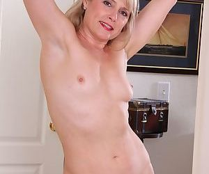 Mature broad Rebecca Hill revealing naked ass while stripping naked