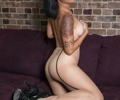 Tattooed Asian stunner Dana Vespoli fingers pussy through fishnet pantyhose