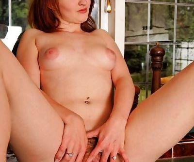 Naughty redhead amateur undressing and spreading her trimmed pussy lips