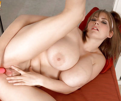 Solo girl Christy Marks flaunting massive boobs while toying shaved vagina