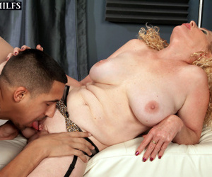 Older blonde woman Charlie seduces younger Latino male in a black miniskirt