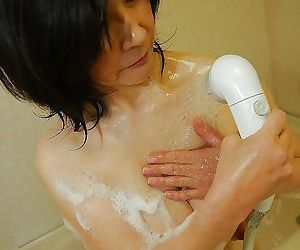 Sassy asian mature lady with unshaven pussy and nice tits taking shower