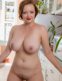 Busty mature slut sheds her tight shirt & panties to squat nude in the kitchen