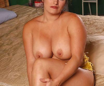 Latina BBW bares her huge boobs before masturbating on her bed