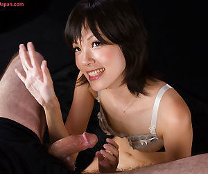 Japanese chick licks cum from her fingers after jerking off a cock