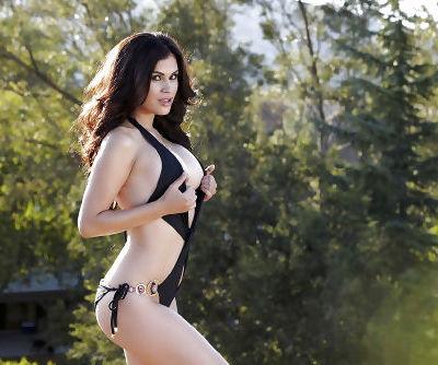 Latina babe Vanessa Veracruz showing off big pornstar tits and ass outdoors