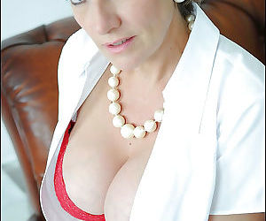 Lady Sonia is posing on the sofa and showing her sexy boobies