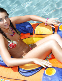 Young hottie with pigtails Tiffany Tyler posing in bikini by the pool