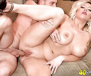 Older blonde mom Ginger Black baring large tits before hardcore anal sex