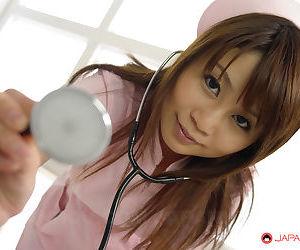 Lusty Japanese nurse Honami Isshiki mouth fucked in a gangbang
