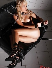 Zoftick blonde with shaved love holes posing nude and chained