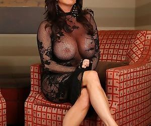 Mature mom Rachel Aziani uncovers her massive boobs and bends over showing ass