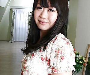 Asian teen with no panties under her miniskirt exposing her shaved gash