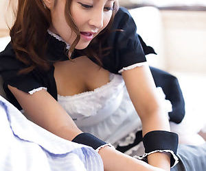 Cute Japanese maid gives her boss a handjob after he watches her masturbate