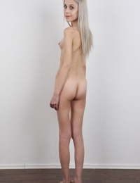 Skinny 18 year old virgin Natalia takes off her clothes to stand in the nude