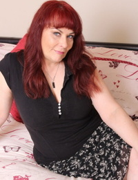 Mature redhead housewife works her seduction magic on a younger boy
