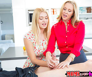 Clothed mom Julia Ann teaches teen girl Natalia Starr how to suck cock