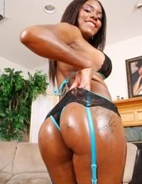 African American chick Candice Nicole exchanges hot lingerie and hosiery