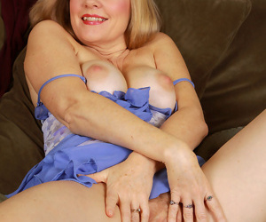 Beautiful mature Lilli fondling her big breasts and spreading pussy wide