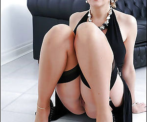 Saucy mature lady in high-heeled shoes exposes her big jugs and pink cunt