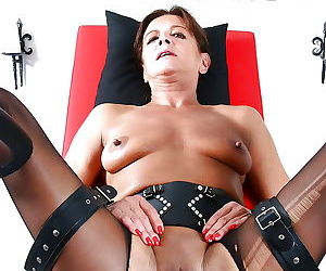 Older Euro woman Lady Sarah squirting for fetish photos while ball gagged
