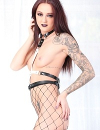 Solo model Joanna Angelstein poses nude in shit kicking boots and fishnets