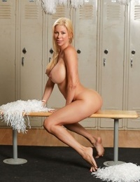 Hot blonde with massive big tits spreads with her pom poms in the locker room