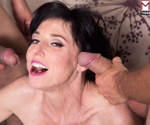 Busty cougar Karen Kougar invites a couple of boys to give her a DP