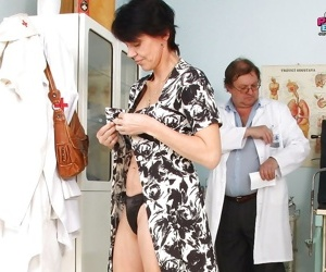 Mature lady gets her pussy stuffed with a toy at the gynecologist