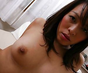 Fuckable asian MILF posing nude and showcasing her hairy gash in close up