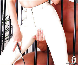 Kinky mature babe with big tits and sexy ass teasing her caged slave