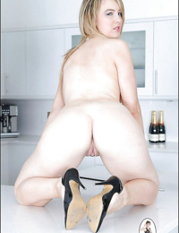 Blonde fetish babe with big jugs posing naked and spreading her legs