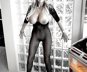 Frisky housewife taking off her miniskirt and posing in sexy nylon suit