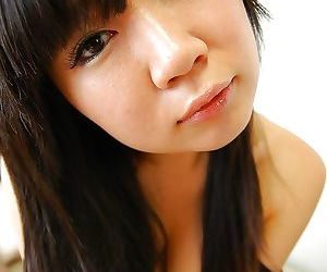 Smiley asian teen Miharu Kase undressing and spreading her lower lips