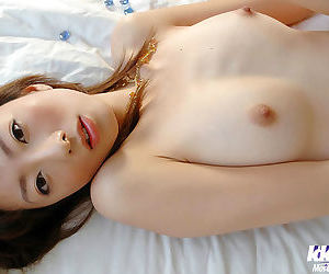 Lovely asian babe with tiny tits stripping off her panties