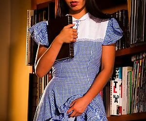 Japanese female Marica Hase flashes her panties while taking a book from stack