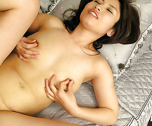 Smiley asian sweetie gets her bushy cunt licked and cocked up