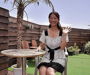 Asian MILF Miki Sugimoto rubs her slit under her panties and gets naked