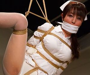 Hot Asian nurse Marica Hase gets involved in a rough bondage sex play