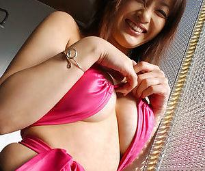 Big busty asian babe Sakura Shiratori stripping and posing in panties