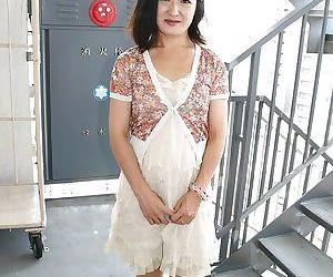 Asian MILF Chiyo Yamabe lowering her panties and exposing her hairy slit