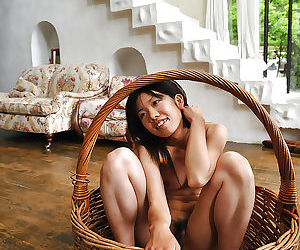 Slim asian babe with tiny tits spreading her legs and exposing her bush