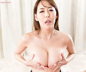 Japanese chick jerks off a cock and rubs the jizz into her nice tits