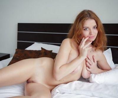 Beautiful redhead Glenda A poses seductively showing perfect tits & tiny twat
