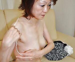 Shy mature asian lady Takako Kumagaya undressing and spreading her legs