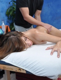 Lovely babe with petite bosoms gets nailed hardcore on the massage table