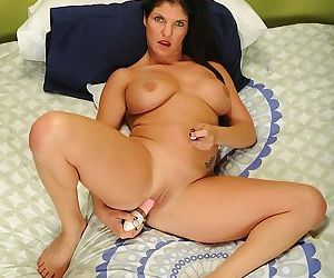 Gorgeous mature mom Coralyn Jewel masturbating with a toy up her ass