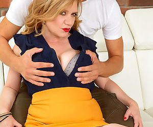 Busty older woman Cilla seduces a younger man for pussy lick with her big tits