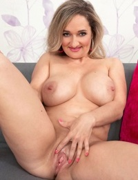 Exotic MILF with big knockers Amelie Azzure gets naked and plays with her muff